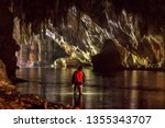 Tourists Explore The Cave Of...