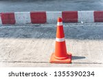 red orange traffic cone on... | Shutterstock . vector #1355390234