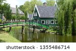 traditional houses and mills of ... | Shutterstock . vector #1355486714
