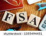 Flexible Spending Account FSA from wooden cubes.