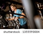 young man doing exercise on... | Shutterstock . vector #1355593004