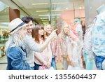 group of teenagers targeting... | Shutterstock . vector #1355604437