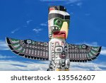 a totem wood pole in the blue... | Shutterstock . vector #135562607