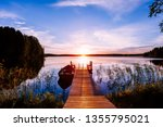 Wooden Pier With Fishing Boat...