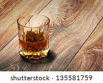 whiskey in glasses on wooden... | Shutterstock . vector #135581759