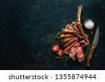 grilled dry aged tomahawk steak ... | Shutterstock . vector #1355874944