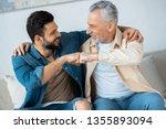 cheerful retired man fist... | Shutterstock . vector #1355893094