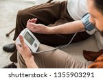 man holding blood pressure...   Shutterstock . vector #1355903291