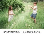 a boy with a girl playing in a... | Shutterstock . vector #1355915141