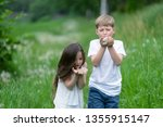 a boy with a girl playing in a... | Shutterstock . vector #1355915147