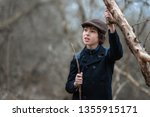portrait of a boy in a coat and ... | Shutterstock . vector #1355915171