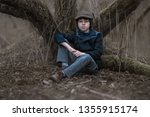 portrait of a boy in a coat and ... | Shutterstock . vector #1355915174