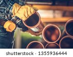 Construction Worker Buying Sanitary Plastic Pipes. Industrial Theme. - stock photo