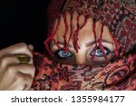 arab lady from afghanistan with ... | Shutterstock . vector #1355984177