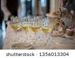 glasses with champagne on a... | Shutterstock . vector #1356013304