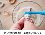 jeweller hand cleaning and... | Shutterstock . vector #1356090731
