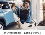 women buying the car. ladies in ... | Shutterstock . vector #1356144917