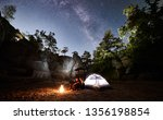 young couple hikers man and... | Shutterstock . vector #1356198854
