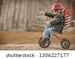 boy in the image of a rider and ... | Shutterstock . vector #1356227177