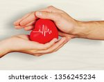 man and woman holding red heart ... | Shutterstock . vector #1356245234