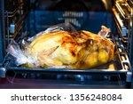 big baked christmas turkey | Shutterstock . vector #1356248084