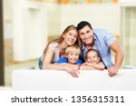 beautiful smiling family on... | Shutterstock . vector #1356315311