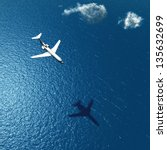 airplane flies over a sea | Shutterstock . vector #135632699