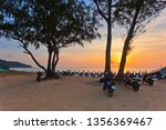 scooters parked on the seashore ... | Shutterstock . vector #1356369467
