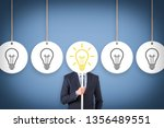 idea concepts with light bulbs... | Shutterstock . vector #1356489551
