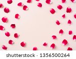 Stock photo design concept top view of red rose petal pattern on pink background with circle shape for mother 1356500264