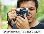 man with analog camera | Shutterstock . vector #1356524324