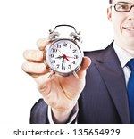 man with an alarm clock in a... | Shutterstock . vector #135654929