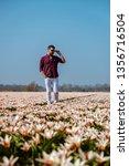 Young Men In Flower Field...