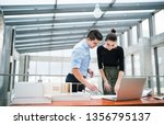 two young architects with... | Shutterstock . vector #1356795137