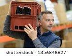 man carrying glass bottles of...   Shutterstock . vector #1356848627