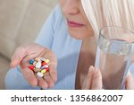 closeup of unhealthy woman feel ... | Shutterstock . vector #1356862007
