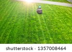 lawn mower with worker on a... | Shutterstock . vector #1357008464