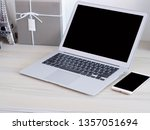 modern laptop with white phone... | Shutterstock . vector #1357051694