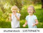 charming little children hunts... | Shutterstock . vector #1357096874
