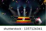 fans hold the flag of uganda... | Shutterstock .eps vector #1357126361