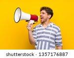 blonde man over yellow wall... | Shutterstock . vector #1357176887