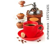 Cup of coffee, grinder and sweet cupcakes on a white. - stock photo