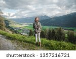 young tourist with a backpack... | Shutterstock . vector #1357216721