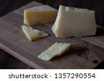 parmesan cheese on a wooden...   Shutterstock . vector #1357290554