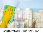 cleaning windows with special... | Shutterstock . vector #1357293464