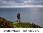 woman on the edge of a cliff... | Shutterstock . vector #1357337177