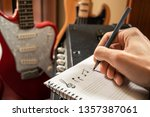 Young man composing music in a...