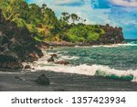 waves crashing into the lava... | Shutterstock . vector #1357423934