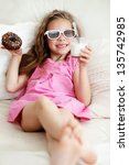 Kid Girl Eating Sweet Donuts...
