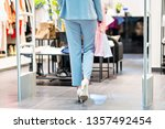 happy woman shopping for... | Shutterstock . vector #1357492454